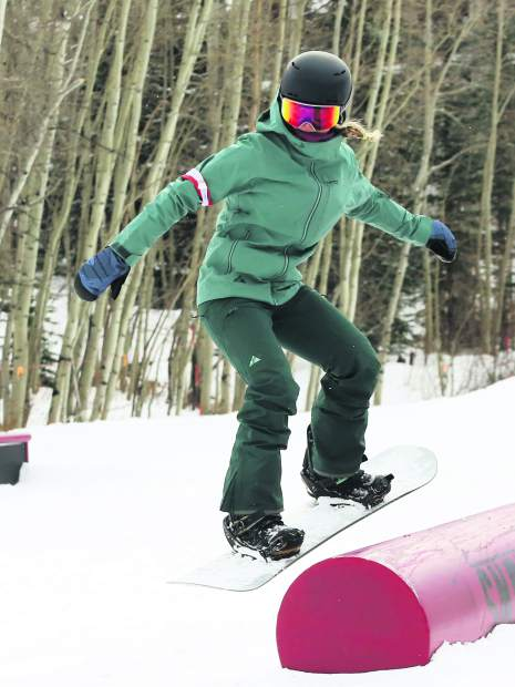 Jordie Karlinski competes in the Thanksjibbing rail jam contest on Friday, Nov. 23, 2018, at Snowmass Ski Area. (Photo by Austin Colbert/The Aspen Times).