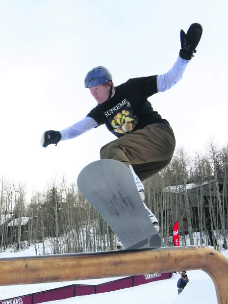 Logan Lauffer competes in the Thanksjibbing rail jam contest on Friday, Nov. 23, 2018, at Snowmass Ski Area. (Photo by Austin Colbert/The Aspen Times).