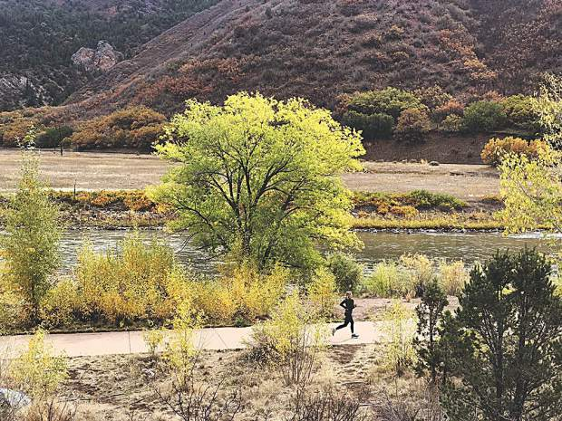 Christy Mahon mid-stride on the Glen Canyon bike path during the Glenwood Canyon Shuffle Half-Marathon on Oct. 6. Ted Mahon photo.