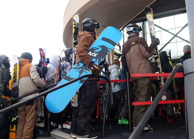 People wait in line to be among the first up Aspen Mountain for opening day on Saturday, Nov. 17, 2018. (Photo by Austin Colbert/The Aspen Times).