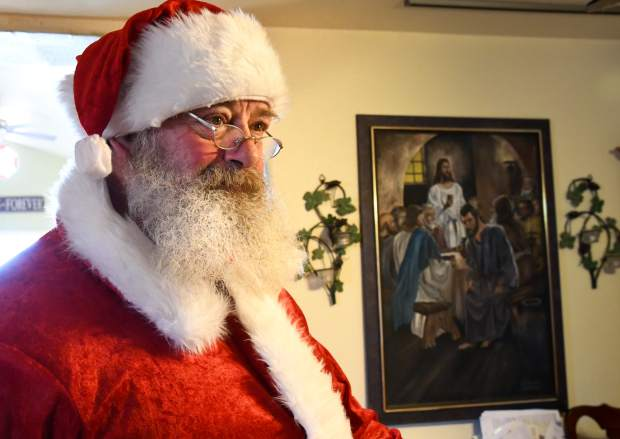 Kim Antonelli prepares for an evening as Santa Claus at his home in Silt.