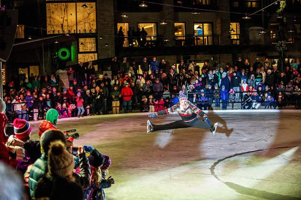 Olympic figure skater Paul Wylie performing on the plaza ice rink at the Snowmass Base Village grand opening Saturday night.