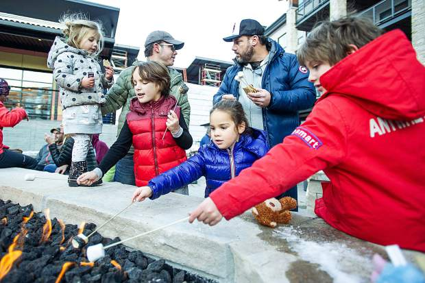 Right to left, Jagger, 7, Chloe, 4, Jack, 7, and Mila, 3, roast marshmellows Saturday at Snowmass Base Village.