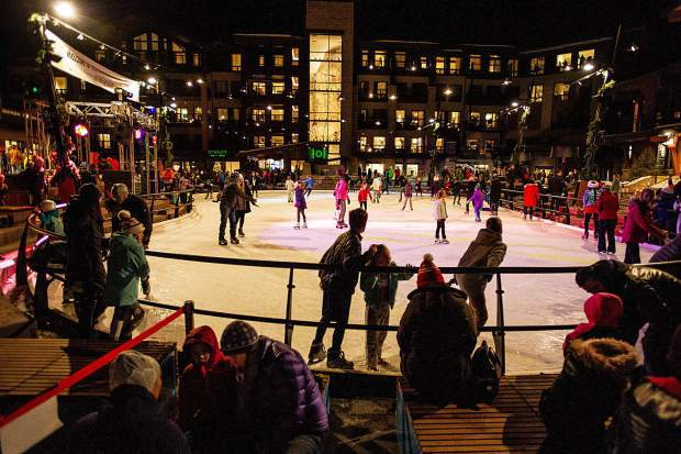 Skaters enjoy the ice rink in Snowmass Base Village Saturday night after the performances for the grand opening.