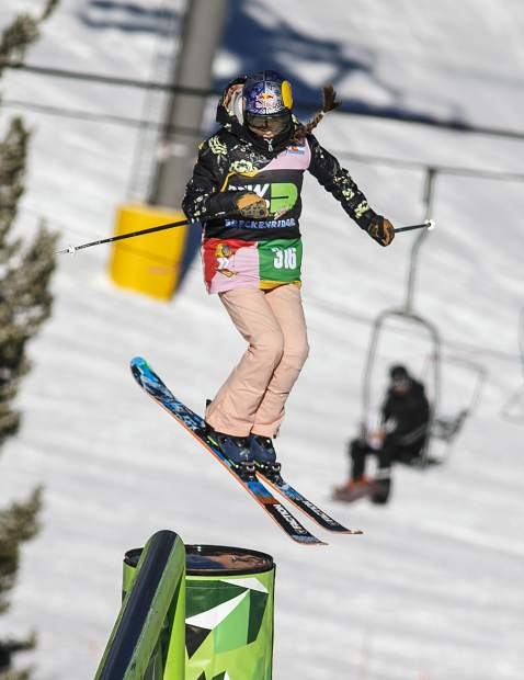 Kelly Sildaru, of Estonia, spins in midair following the rail grind in the Dew Tour women's slopestyle ski finals on Thursday, Dec. 13, at Breckenridge Ski Resort. Sildaru took home a first-place finish.
