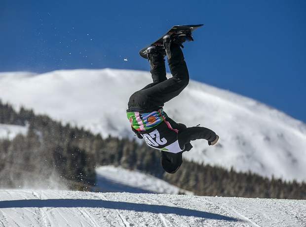 Paralympic medalist Mike Minor, of Frisco, does a flip while racing down the course during the Dew Tour adaptive snowboard cross men's finals on Thursday, Dec. 13, at Breckenridge Ski Resort. Minor placed 10th following a crash in the second round, though he was clearly having fun messing aroudn with tricks during his time out there on the course.