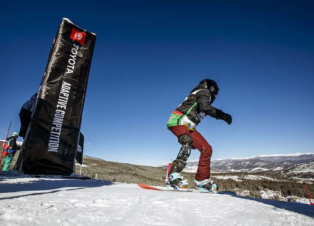 Canadian Paralympian Michelle Salt takes off for the banked slalom course in the Dew Tour adaptive snowboard women's finals on Thursday, Dec. 13, at Breckenridge Ski Resort. Salt, who suffered a motorcycle accident in 2011 that left her on life support for one week, placed fourth in the finals.