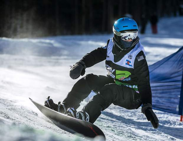 Zach Miller races down the course during the Dew Tour adaptive snowboard cross men's finals on Thursday, Dec. 13, at Breckenridge Ski Resort. Miller placed third.