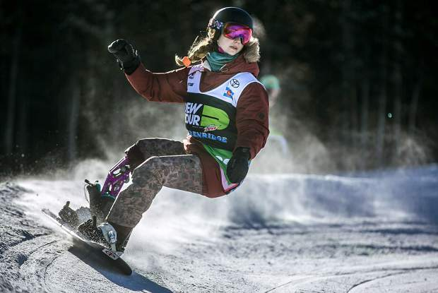 Two-time Paralympic medalist Brenna Huckaby, of Louisiana, races down the course during the Dew Tour adaptive snowboard banked slalom women's finals on Thursday, Dec. 13, at Breckenridge Ski Resort. Huckaby took home first place for the second consecutive year
