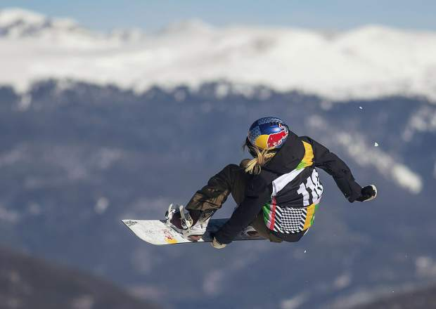 Austria's Anna Gasser executes a trick in midair at the Dew Tour snowboard slopestyle women's finals on Friday, Dec. 14, at Breckenridge Ski Resort. Gasser placed first.