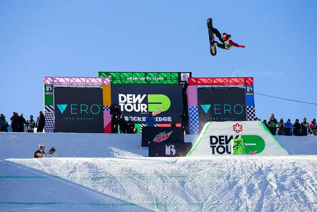Scotty James executes a trick the men's superpipe snowboard finals of Dew Tour Saturday, Dec. 15, at Breckenridge Ski Resort.