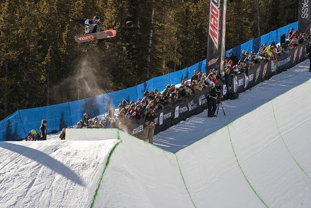 Chase Josey executes a trick the men's superpipe snowboard finals of Dew Tour Saturday, Dec. 15, at Breckenridge Ski Resort.