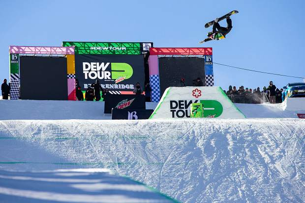 Jake Pates executes a trick in the men's superpipe snowboard finals of Dew Tour Saturday, Dec. 15, at Breckenridge Ski Resort.