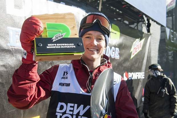 Scotty James with the first place award following the men's superpipe snowboard finals of Dew Tour Saturday, Dec. 15, at Breckenridge Ski Resort.