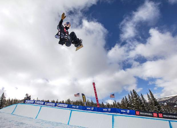 Toby Miller, of California, rotates in mid-air at the Toyota U.S. Grand Prix World Cup halfpipe snowboard men's finals on Saturday, Dec. 8, at Copper Mountain Resort.