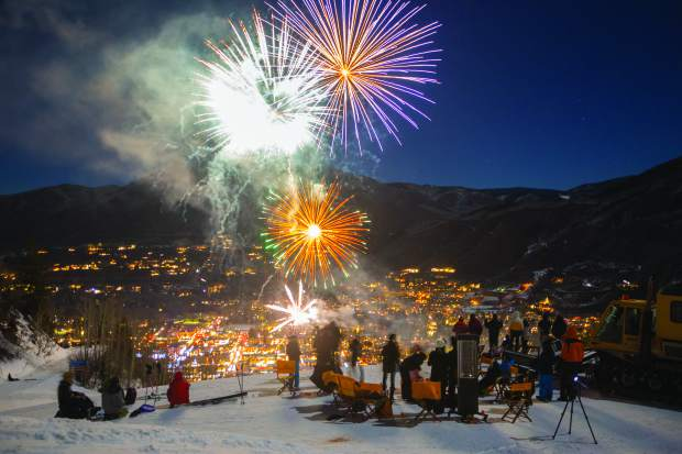 fireworks shot over the town of aspen colorado on new years eve 2017