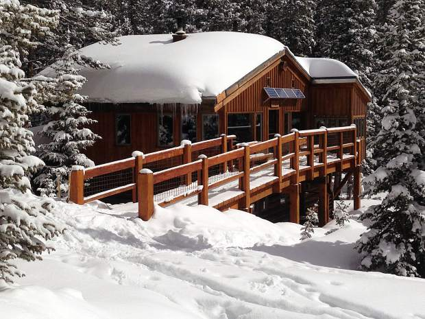 The Beatty Bear Hut catches sun after a snowstorm.