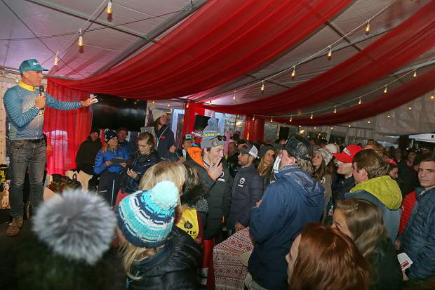OxiClean's Anthony Sullivan leads the post-race auction during the Audi Ajax Cup on Sunday, Dec. 30, 2018, at the base of Aspen Mountain.