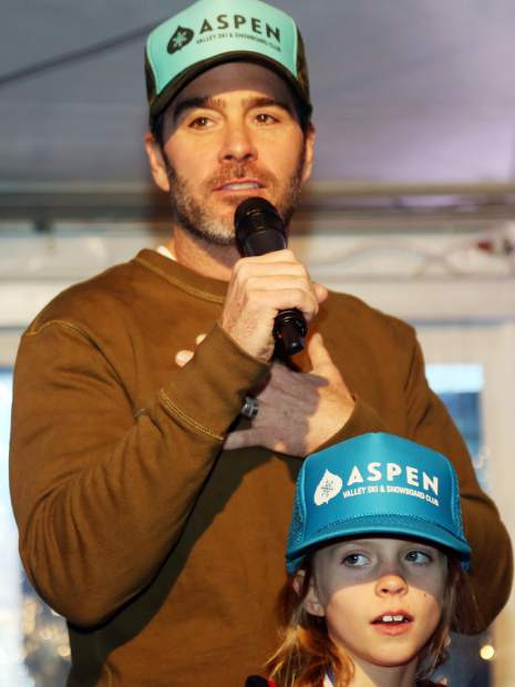 NASCAR driver Jimmie Johnson, with daughter Evie, talks about his auction item as part of the Audi Ajax Cup on Sunday, Dec. 30, 2018, at the base of Aspen Mountain.