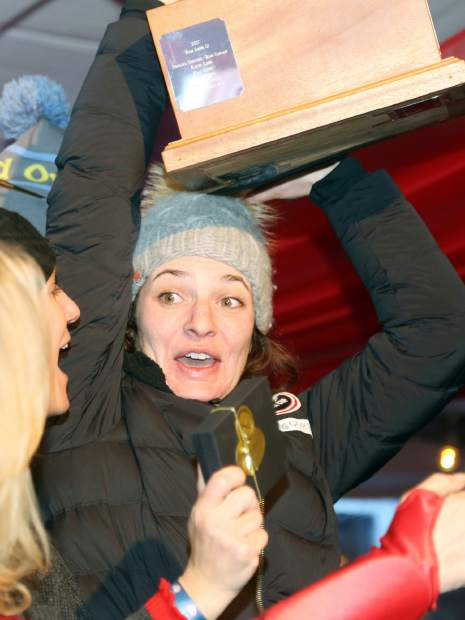 Former World Cup ski racer Megan McJames holds up the championship trophy after winning the Audi Ajax Cup on Sunday, Dec. 30, 2018, on Aspen Mountain.