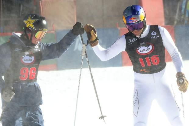 Olympic halfpipe skier Alex Ferreira, left, and big mountain skiing icon Chris Davenport bump fists after racing in the Audi Ajax Cup on Sunday, Dec. 30, 2018, on Aspen Mountain. (Photo by Austin Colbert/The Aspen Times)