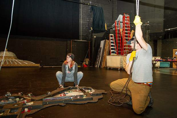 Aspen Santa Fe production manager Danny Bacheldor uses his body weight to hold down a set piece while preparing the Nutcracker set on Dec. 1 at the Aspen District Theater.