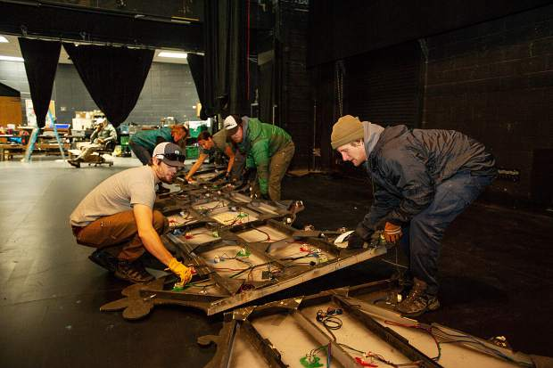 Production crew members prepare one of the set pieces in preparations for the Aspen Santa Fe Ballet's,