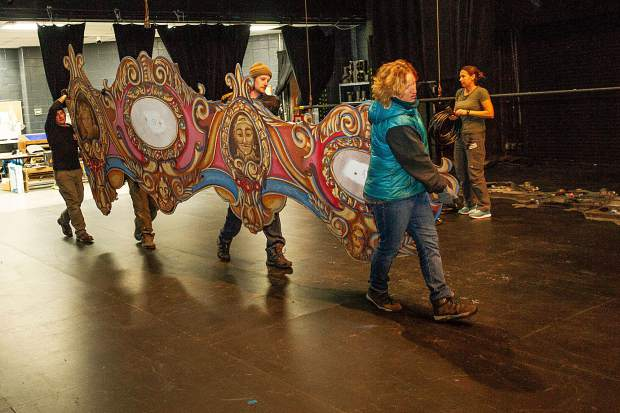 Production crew members, Kate Redmond, front, Cody Kosinski, Kyle Pieti, and Brock Jacobson unload one of the set pieces in preparations for the Aspen Santa Fe Ballet's,