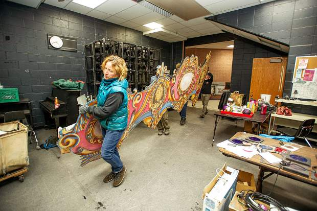 Production crew members, Kate Redmond, front, Kyle Pieti, Cody Kosinski, and Brock Jacobson unload one of the set pieces in preparations for the Aspen Santa Fe Ballet's,