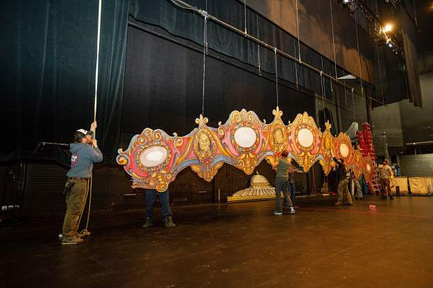Crew members hoist up one of the set pieces in preparations for the Aspen Santa Fe Ballet's,