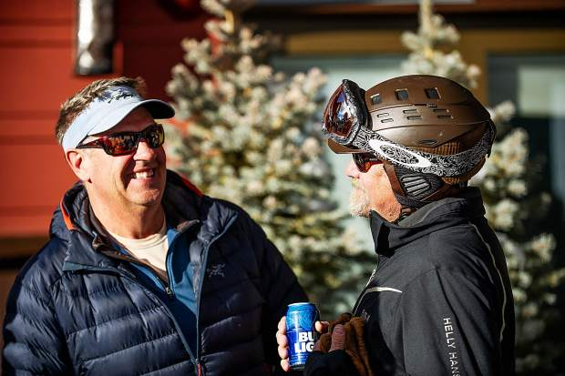 Bob Beattie's son Zeno Beattie, right, shares a laugh at the celebration of his father's life at Aspen Highlands on Saturday.
