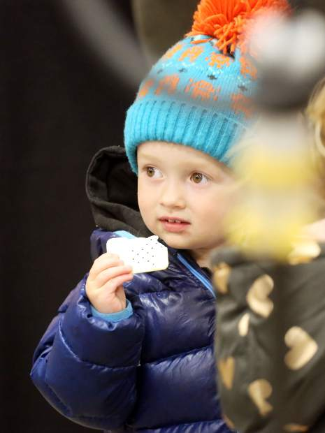 Indio Umbarger, 2, snacks on a cracker Friday, Nov. 30, 2018, during the dedication ceremony for the new Snowmass-Wildcat Fire Protection District fire station in Snowmass Village. (Photo by Austin Colbert/The Aspen Times)