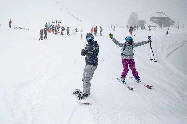 Katie Houser and Max Rispoli head towards Highland Bowl after ski patrol dropped the rope on Saturday.