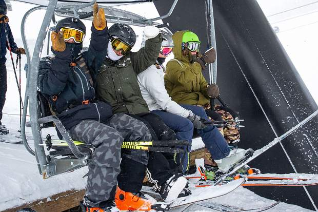 Excitement on the Exhibition lift at Aspen Highlands for opening day on Saturday.