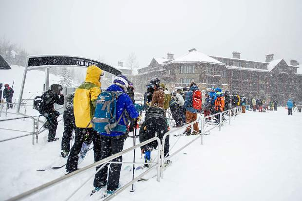 Skiers and snowboarders wait in line at the Exhibition lift at Aspen Highlands for opening day for the 2018-19 season.