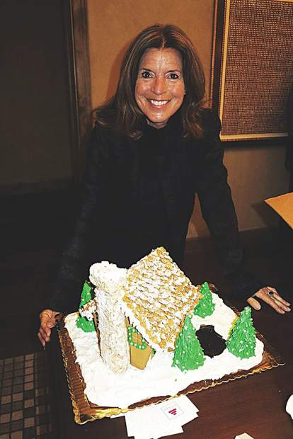 Gingerbread Workshop host Karen Wing for the win! At the sponsor reception, several professionally decorated houses were raffled off including this specialty from the Hotel Jerome.
