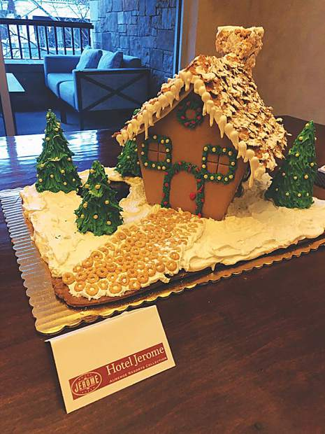 A gingerbread house creation by the Hotel Jerome's pastry chef on display at Residences at The Little Nell.