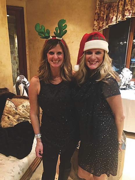 Sisters Allison Miller and Tracy Miller-Hubbard embracing the Christmas spirit.