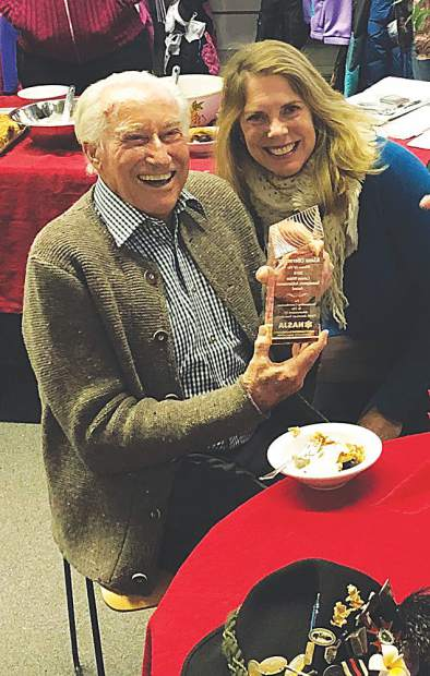 Klaus Obermeyer on his 99th birthday with an award presented by Cindy Hirshfeld. Courtesy photo.