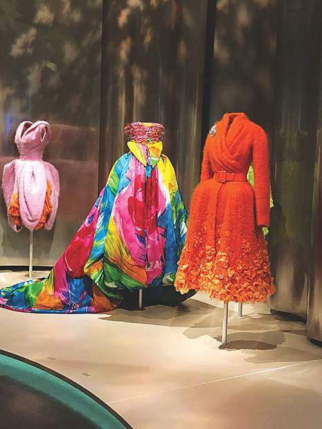 Dior dresses on display at Denver Art Museum including the one at center designed by Gianfranco Ferré and used for the exhibit's poster.