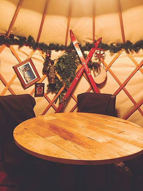 As a guest at EMP Winter House, your options include dining in a rustic chic yurt like this.