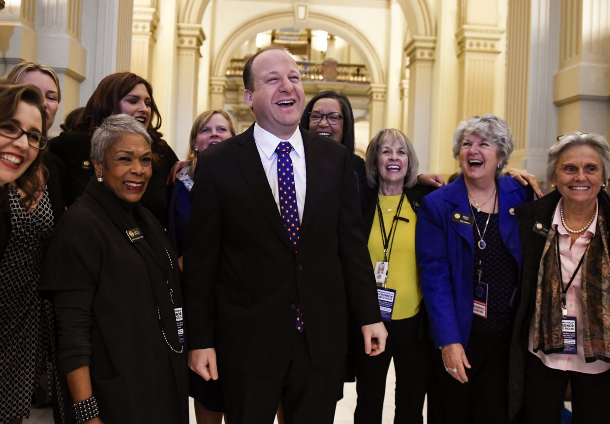 Colorado Governor elect Jared Polis jokes with members of the state house and senate before his inauguration at the Colorado State Capitol in Denver on Tuesday, Jan. 8, 2019.
