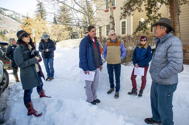 The City of Aspen's engineering senior project manager Pete Rice, center, takes City Council members, including Ward Hauenstein, right, around Aspen to scout locations of concern for pedestrian sidewalks on Tuesday morning before the council meeting that night. Pictured here on East Hopkins Avenue.