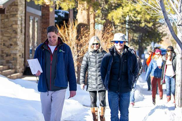 The City of Aspen's engineering senior project manager Pete Rice, left, takes City Council members, including Bert Myrin, right, and Ann Mullins, center, around Aspen to scout locations of concern for pedestrian sidewalks on Tuesday morning before the council meeting that night.