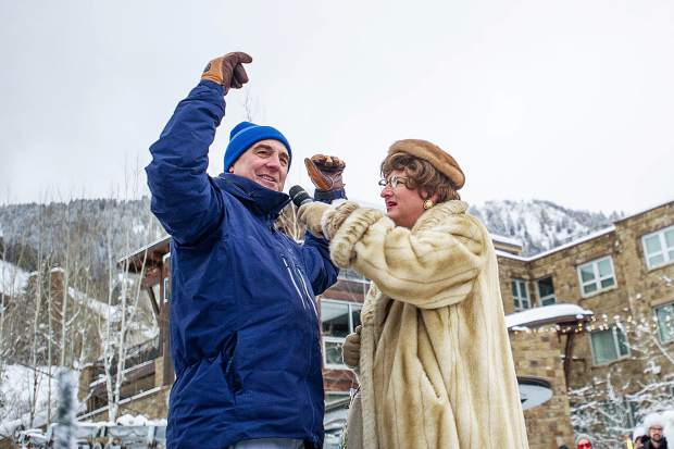 Pitkin County Sheriff Joe DiSalvo getting introduced as one of the annual judges for the Aspen Gay Ski Week downhill costume parade on Friday by MC Sister Helen Holy.