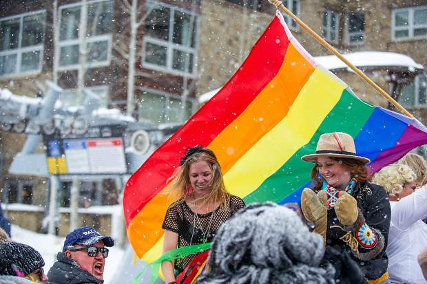 Snowmass Tourism employees Erin Young, left, and Sara Stookey-Sanchez pour fireball for the judges for the Aspen Gay Ski Week downhill costume competition on Friday. Snowmass Tourism took first place for the second year in a row.