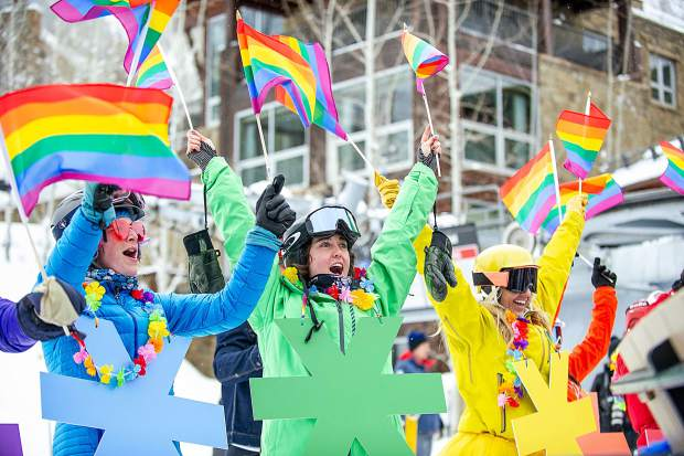 Aspen Ski Co. marketing employees left to right, Tiffany Cook, Xanthe Demas, and Lauren Myatt in their rainbow Give A Flake campaign outfits at the Aspen Gay Ski week downhill costum parade on Friday afternoon.