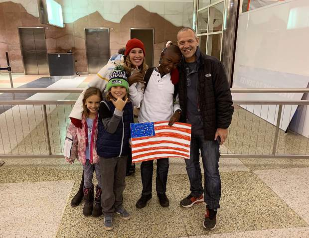 Jonas and the Ohayon family after his arrival at the Denver International Airport in November.