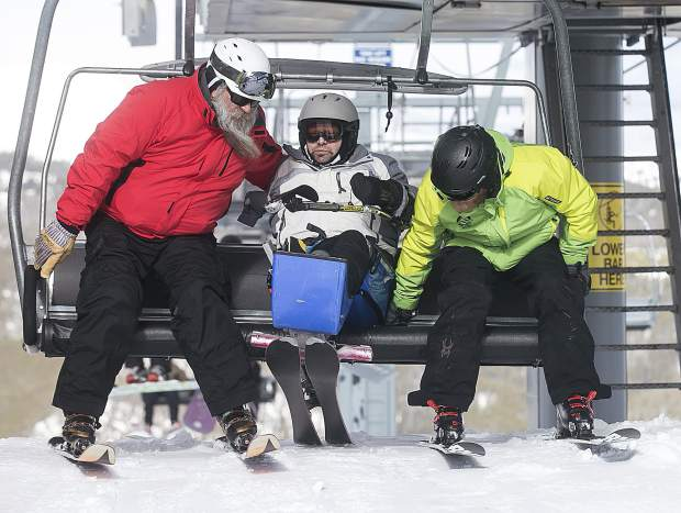 Gary Verrazano of Denver gets off the chair with the help of guides on Thursday at Keystone Resort.