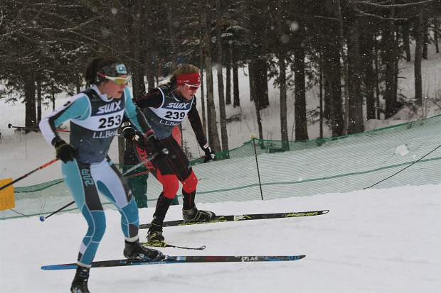 Carbondale's Kate Oldham, right, competing with Aspen Valley Ski and Snowboard Club, races at January's U.S. nationals in Vermont.